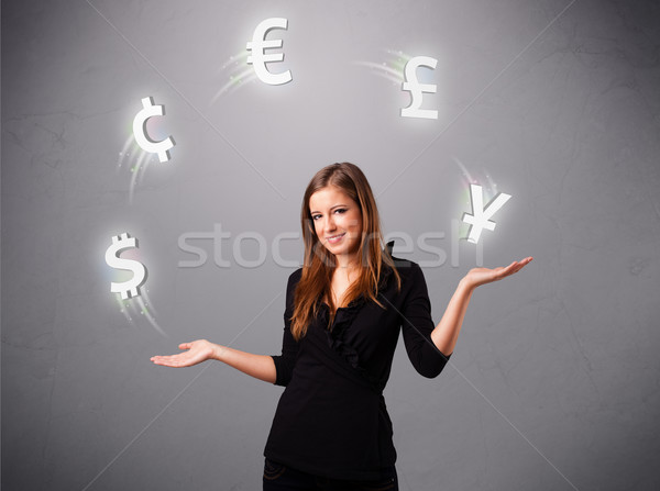young lady standing and juggling with currency icons Stock photo © ra2studio