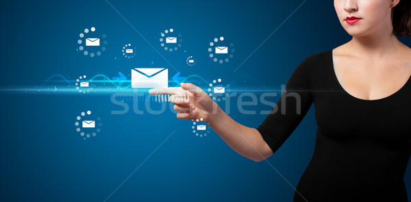 Businesswoman pressing virtual messaging type of icons Stock photo © ra2studio