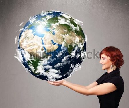 Csinos lány tart 3D Föld fiatal lány Stock fotó © ra2studio