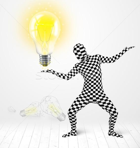 Férfi egészalakos izzó villanykörte vicces öltöny Stock fotó © ra2studio