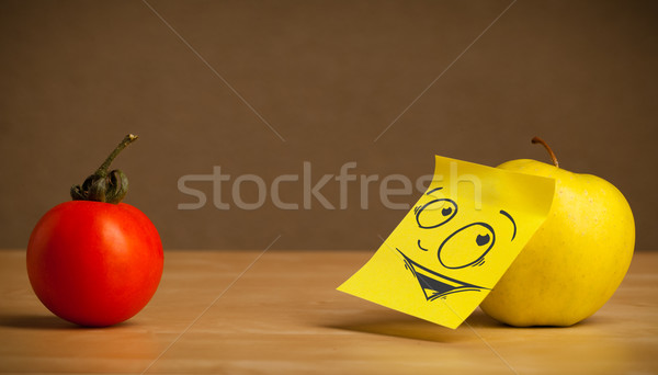 Stock photo: Apple with post-it note looking curiously at tomato