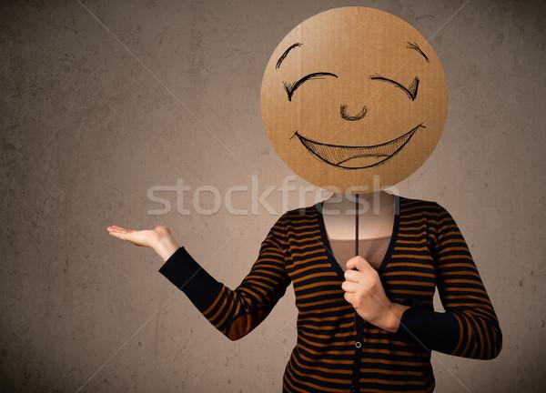 Fiatal nő tart mosolygós arc tábla fiatal hölgy Stock fotó © ra2studio