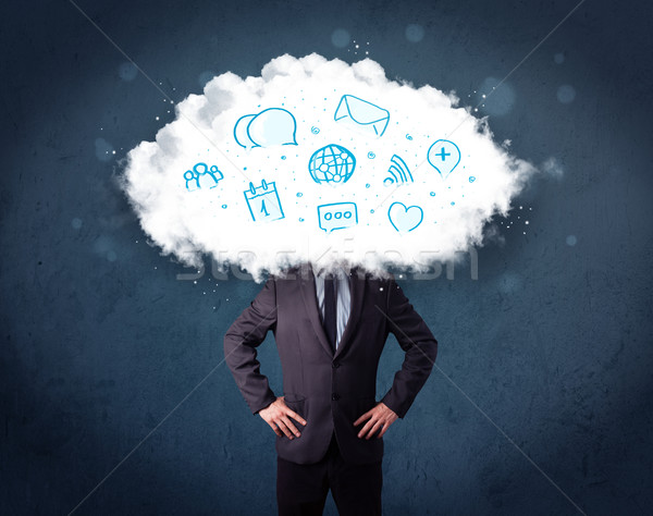 Man in suit with cloud head and blue icons Stock photo © ra2studio