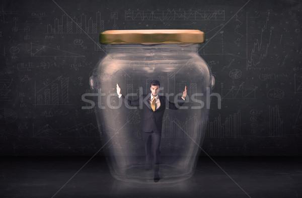 Business man closed into a glass jar concept Stock photo © ra2studio