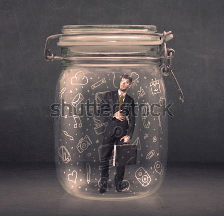 Business man captured in glass jar with hand drawn media icons c Stock photo © ra2studio