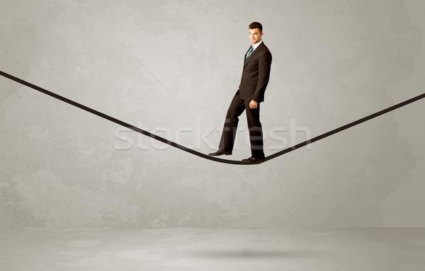 Verkoper lopen touw grijs ruimte zakenman Stockfoto © ra2studio