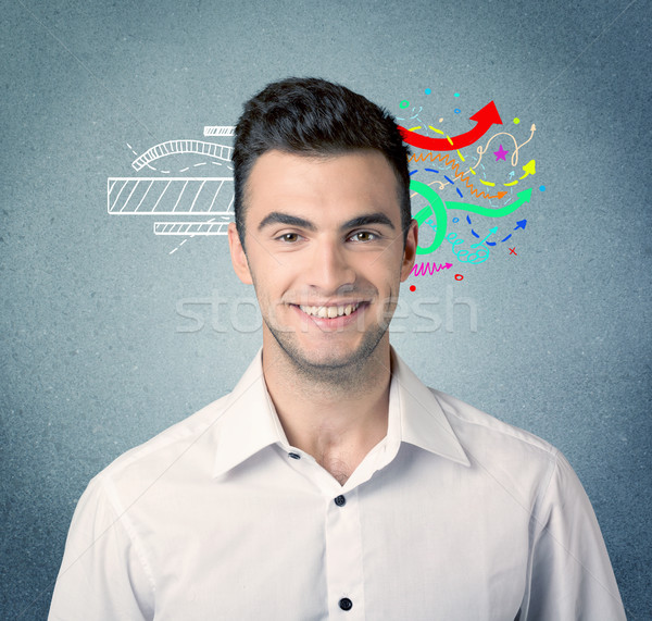 Happy creative business guy with illustration Stock photo © ra2studio