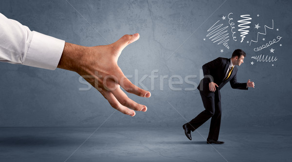 Stressful businessman running from a big hand  Stock photo © ra2studio