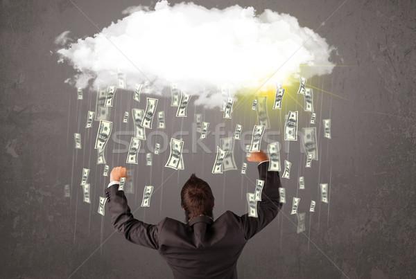 Hombre de negocios traje mirando nube caer dinero Foto stock © ra2studio
