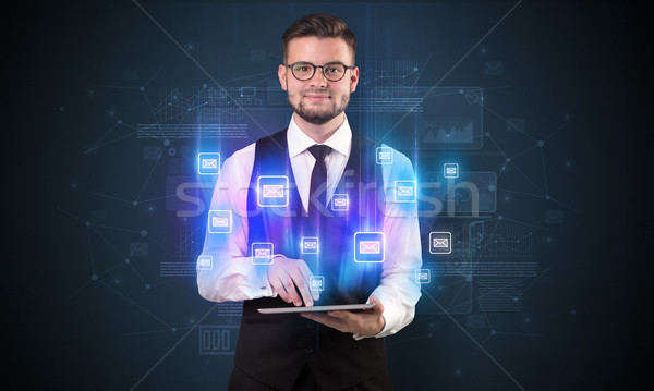 Mailing concept with businessman and tablet Stock photo © ra2studio