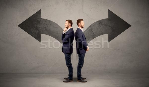 üzletember kettő lehetőségek fiatal választ irányok Stock fotó © ra2studio
