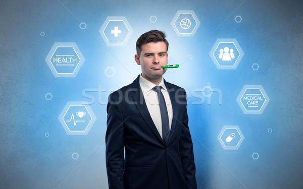 Sick businessman with medical care concept Stock photo © ra2studio