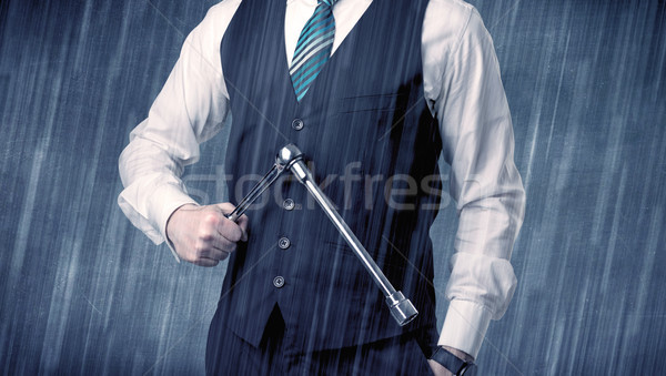 Employer standing with tool on his hand Stock photo © ra2studio