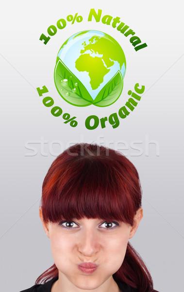 Młoda dziewczyna patrząc zielone eco podpisania głowie Zdjęcia stock © ra2studio