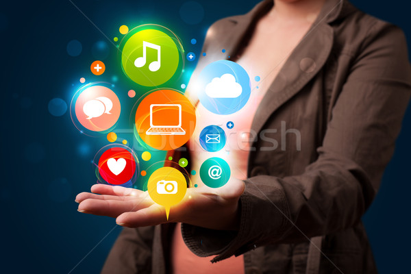 Young woman presenting colorful technology icons and symbols Stock photo © ra2studio