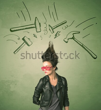 Young girl with devil horns and wings drawing Stock photo © ra2studio