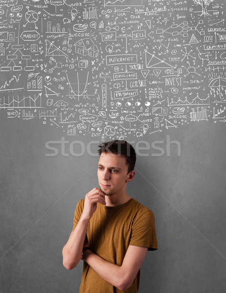 Thoughtful young man with sketched charts over his head Stock photo © ra2studio