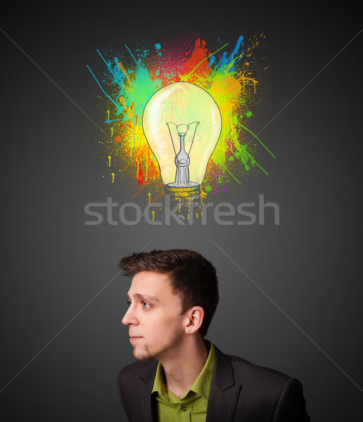 Businessman thinking with lightbulb above his head Stock photo © ra2studio