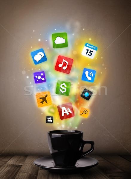 Coffee mug with colorful media icons Stock photo © ra2studio