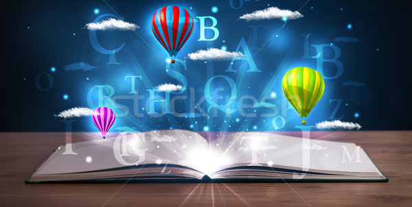 Nyitott könyv izzó fantázia absztrakt felhők léggömbök Stock fotó © ra2studio