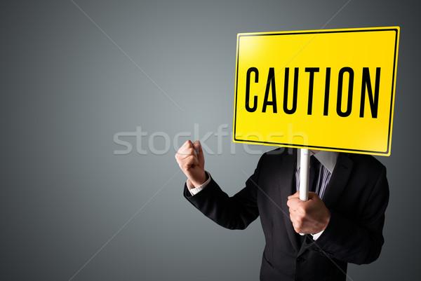 Imprenditore cautela segno piedi giallo Foto d'archivio © ra2studio