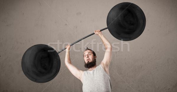 Funny chudy facet wagi nieprawdopodobny Zdjęcia stock © ra2studio
