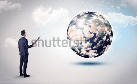 Stock fotó: üzletember · kő · hegy · földgömb · áll · perem