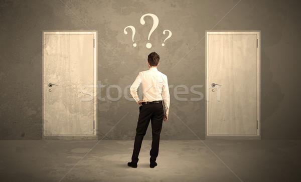 Işadamı ayakta kapılar satıcı iki Stok fotoğraf © ra2studio