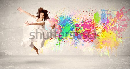 Beautiful woman jumping with colorful gems and crystals on the b Stock photo © ra2studio