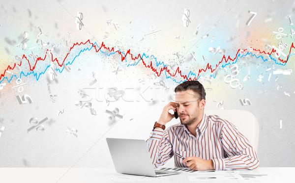 Uomo d'affari seduta tavola mercato azionario grafico 3D Foto d'archivio © ra2studio