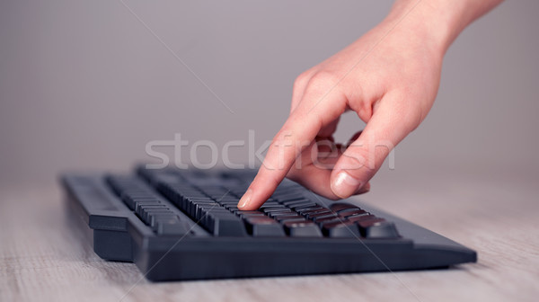Close up of hand pressing keyboard buttons Stock photo © ra2studio
