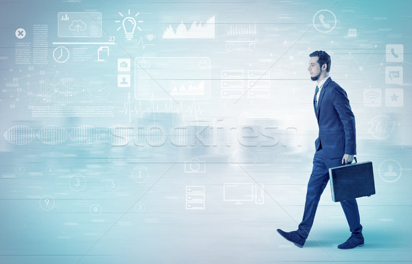 Businessman walking with database concept around Stock photo © ra2studio