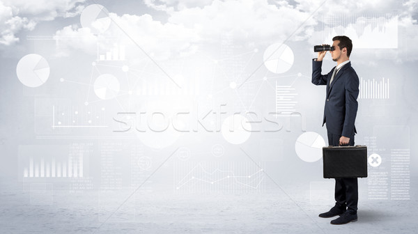 Businessman  looking forward with binoculars Stock photo © ra2studio