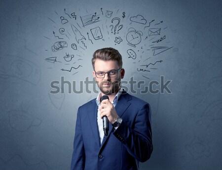Handsome man shooting his head with gun Stock photo © ra2studio