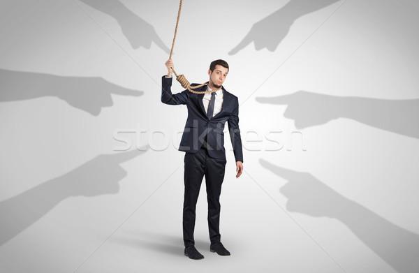бизнесмен самоубийства указывая рук молодые лице Сток-фото © ra2studio