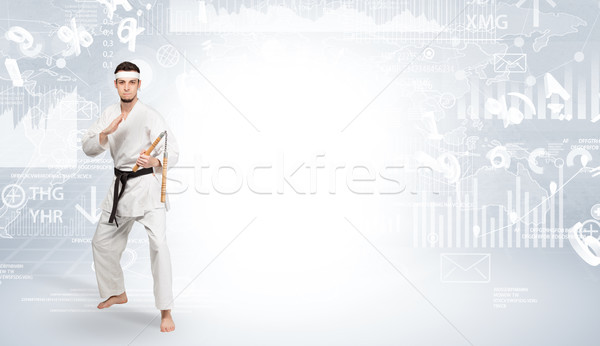 Karate man doing karate tricks on the top of a metropolitan city Stock photo © ra2studio