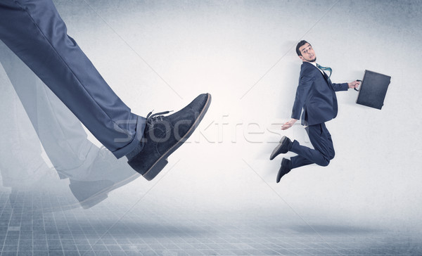 üzletember láb rúg kicsi nagy fiatal Stock fotó © ra2studio
