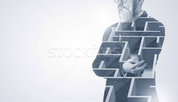 Businessman standing and thinking  with maze Stock photo © ra2studio