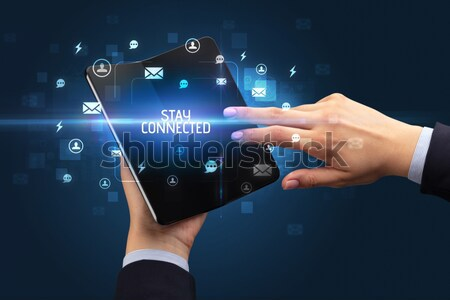 Businessman pressing virtual messaging type of icons Stock photo © ra2studio