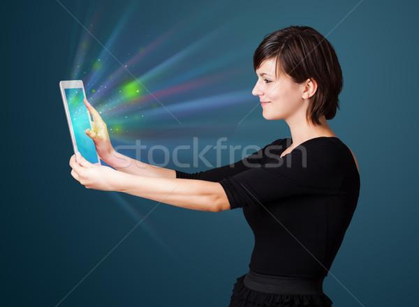 Stockfoto: Jonge · vrouw · naar · moderne · tablet · abstract · lichten