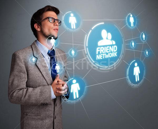 Homem bonito olhando moderno rede social bonito moço Foto stock © ra2studio