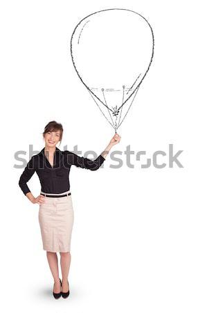Pretty woman holding balloon drawing Stock photo © ra2studio