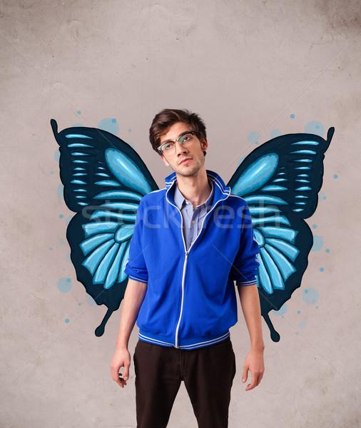 Przystojny młody człowiek Motyl niebieski ilustracja powrót Zdjęcia stock © ra2studio
