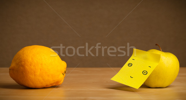 Stock photo: Apple with post-it note looking at lemon