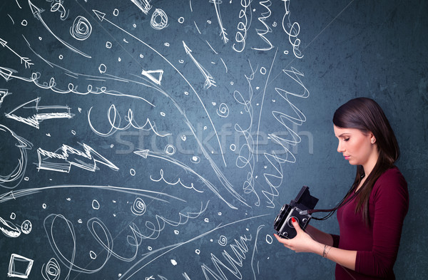 Stock photo: Photographer shooting images while energetic hand drawn lines an