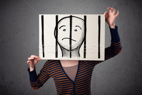 Woman holding a paper with a prisoner behind the bars on it in f Stock photo © ra2studio