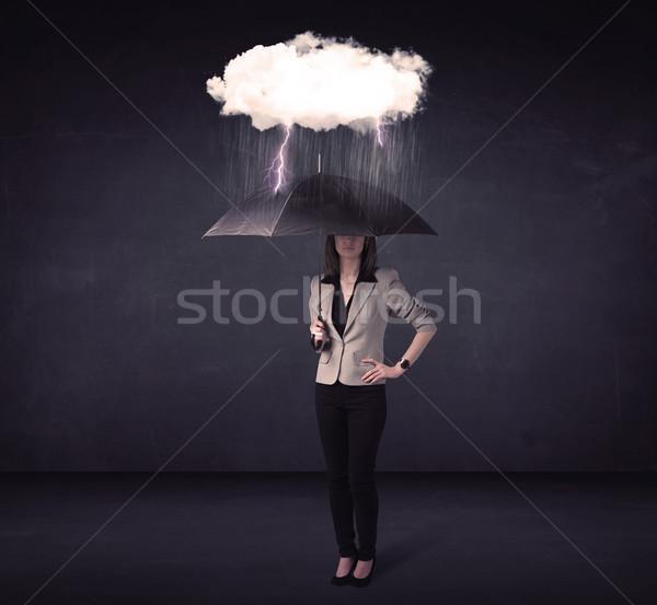 Kobieta interesu stałego parasol mały burzy Chmura Zdjęcia stock © ra2studio