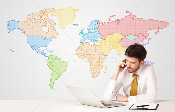 Hombre de negocios colorido mapa del mundo empresario sesión blanco Foto stock © ra2studio