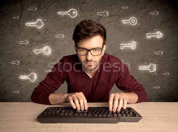 Nerd Guy mot de passe touches Photo stock © ra2studio