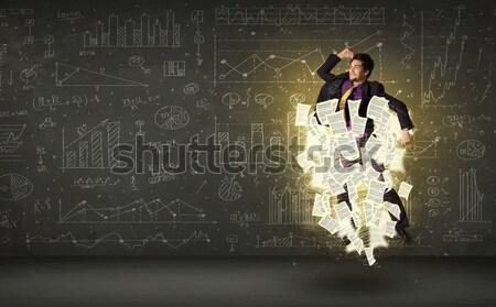 Jóképű üzletember ugrik papír irat felhő Stock fotó © ra2studio